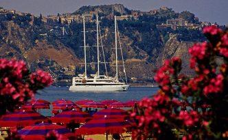 Small cruise ship in in Taorima harbor, Sicily, Italy, courtesy of Dennis Cox LLC